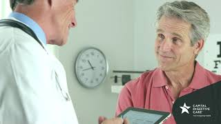 Patient talking with doctor holding ipad