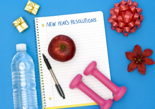 Note pad with New Year's Resolutions written